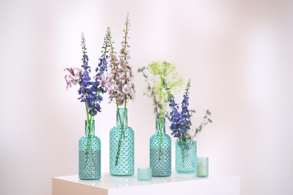 Flowers in decorative glass bottles
